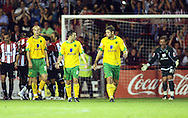 London - Tuesday, August 18th, 2009: Dejected Norwich players from left Jen Bethal Ashou, Wes Hoolahan, Grant Holt and Ben Alnwick after Brentford score the second goal against Norwich City during the Coca Cola League One match at Griffin Park, London. (Pic by Chris Ratcliffe/Focus Images)