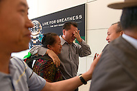 Tou Herr, 45, cries as he greets his sister Maivang Her, who he has not seen in 40 years during a reunion at Sacramento International Airport, Sunday May 12, 2013. Maivang Her and her husband, Chai Ying Moua, two Hmong from a village in northern Laos, reunited with their relatives from Sacramento and Fresno.<br /> Brian Baer/Special to the Bee