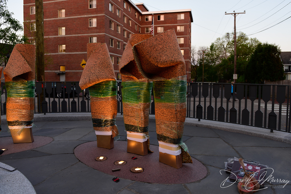 Taken on the evening of May 13, 2015, during final stages of construction of the African Burying Ground Memorial in Portsmouth NH. On this night initial adjustments were made to the lighting of the sculpture figures which had been installed earlier that day.