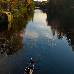 A couple canoes on the Saco River in Hollis, Maine.