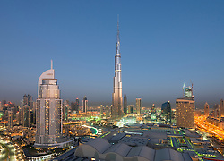 Burj Khalifa , the Dubai Mall and skyline of Downtown Dubai at sunrise in United Arab Emirates