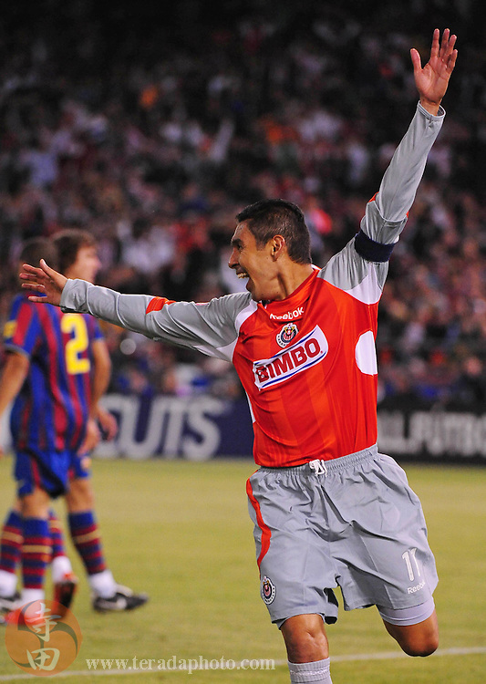 August 8, 2009; San Francisco, CA, USA; Chivas de Guadalajara midfielder Ramon Morales celebrates after scoring a goal during the second half against FC Barcelona in the Night of Champions international friendly contest at Candlestick Park. The game ended in a 1-1 tie.