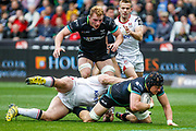 Ospreys No.8 James King is tackled during the Guinness Pro 12 2017 Round 21 match between Ospreys and Ulster at the Liberty Stadium, Swansea, Wales on 29 April 2017. Photo by Andrew Lewis.