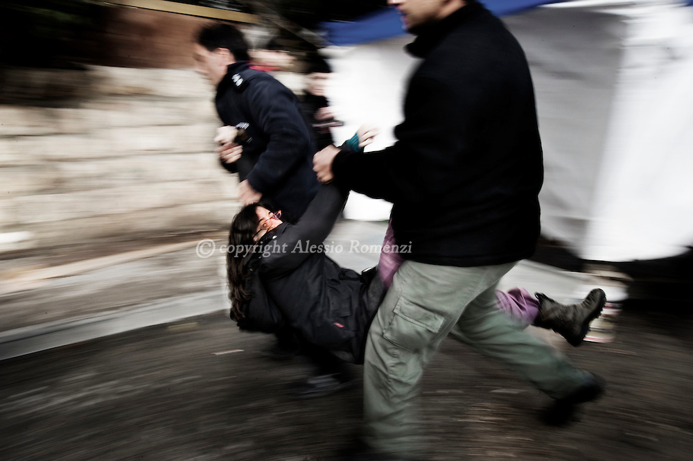 An Israeli activist is detained by Israeli border policemen during a demonstration against Jewish settlements and in solidarity with Palestinian families who were evicted from their houses in east Jerusalem's Sheikh Jarrah neighbourhood on December 18, 2009. Ten activists were arrested during a protest against the eviction of Palestinians in predominantly Arab east Jerusalem..© ALESSIO ROMENZI