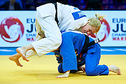 Warsaw, Poland - 2017 April 20: Maryna Cherniak from Ukraine (white) competes with Shira Rishony from Israel (blue) in the women&rsquo;s 48kg repechage during European Judo Championships 2017 at Torwar Hall on April 20, 2017 in Warsaw, Poland.<br /> <br /> Mandatory credit:<br /> Photo by &copy; Adam Nurkiewicz / Mediasport<br /> <br /> Adam Nurkiewicz declares that he has no rights to the image of people at the photographs of his authorship.<br /> <br /> Picture also available in RAW (NEF) or TIFF format on special request.<br /> <br /> Any editorial, commercial or promotional use requires written permission from the author of image.