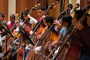 "Rehearsal in the basement of the ""Centro Latinoamericano de Accio?n Social por la Mu?sica (Center for Social Action Through Music)"" with visitors from all Andean States. The ""Fundacion del Estado para el Sistema Nacional de las Orquestas Juveniles e Infantiles de Venezuela"" (FESNOJIV, National Network of Youth and Children Orchestras of Venezuela), also known as El Sistema, is a publicly financed private-sector music-education program in Venezuela, originally called Social Action for Music, founded 1975 by Venezuelan economist and amateur musician Jose? Antonio Abreu."