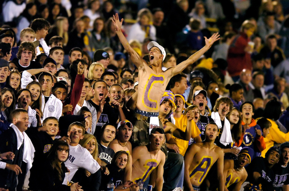 Hickman senior Colin Kemble, 17, center, cheers during a replay of a Hickman sack during the third quarter against cross-town rivak Rock Bridge.