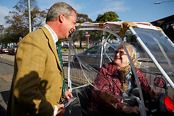 © Licensed to London News Pictures. 09/10/2014. Clacton, UK. Nigel Farage talks to a voter as he visits UKIP campaign office in Clacton-on-Sea during the by-election on Thursday, 9 October, 2014. Photo credit : Tolga Akmen/LNP