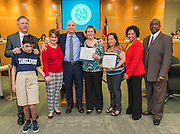 Nathan Graf recognizes school bus driver Miriam Alvarado and attendant Julita Rodriguez for outstanding service during a meeting of the Houston ISD Board of Trustees, January 12, 2017.