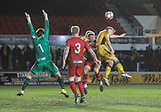 Rhys Healey of Newport County wins the header during the The FA Cup match between Newport County and Alfreton Town at Rodney Parade, Newport, Wales on 15 November 2016. Photo by Andrew Lewis.