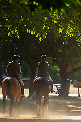 Two riders' horses kick up dust in Hyde Park as another heatwave day begins with temperatures expected to soar. London, July 01 2018.