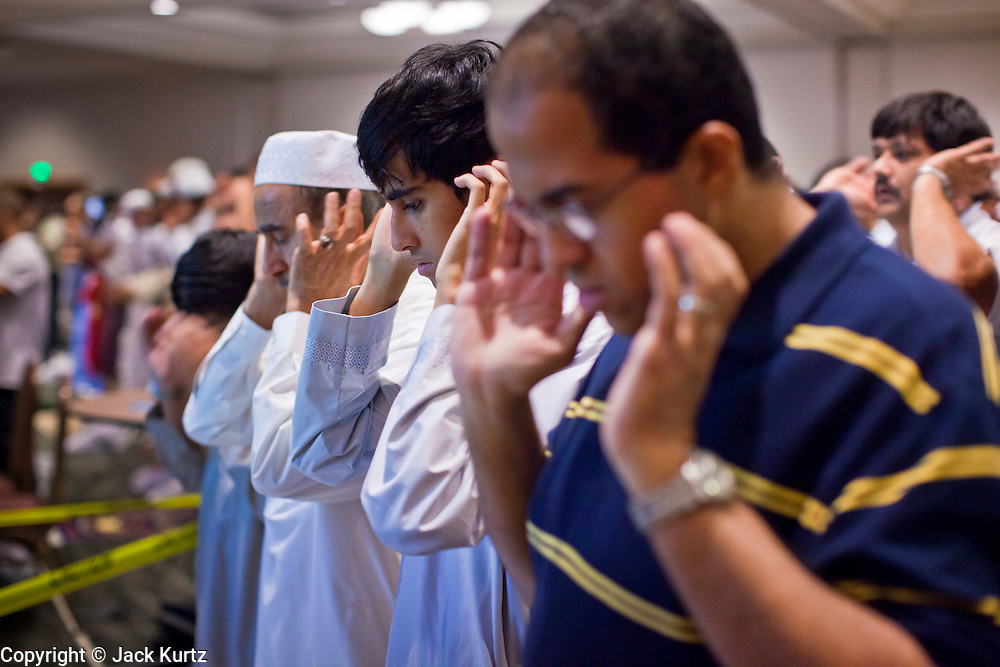"Sept. 10 - GLENDALE, AZ: Muslim men pray during Eid ul-Fitr services in the Glendale Civic Center. More than 3,000 Muslims from the Phoenix area celebrated Eid ul-Fitr, the end of Ramadan, at the Glendale Civic Center in Glendale, AZ, a suburb of Phoenix. Eid ul-Fitr, often abbreviated to Eid, is the Muslim holiday that marks the end of Ramadan, the Islamic holy month of fasting. Eid is an Arabic word meaning ""festivity"", while Fitr means ""conclusion of the fast""; and so the holiday symbolizes the celebration of the conclusion of the month of fasting from dawn to sunset during the entire month of Ramadan. The first day of Eid, therefore, is the first day of the month Shawwal that comes after Ramadan.  Photo by Jack Kurtz"