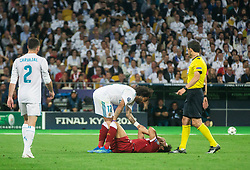 Marcelo  of Real Madrid and Injured Mohamed Salah of Liverpool during the UEFA Champions League final football match between Liverpool and Real Madrid at the Olympic Stadium in Kiev, Ukraine on May 26, 2018.Photo by Sandi Fiser / Sportida