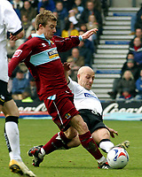 Photo: Dave Linney.<br />Derby County v Burnley. Coca Cola Championship. 11/03/2006 Derby's .Alan Wright (R) slides in to tackle Wade Elliott