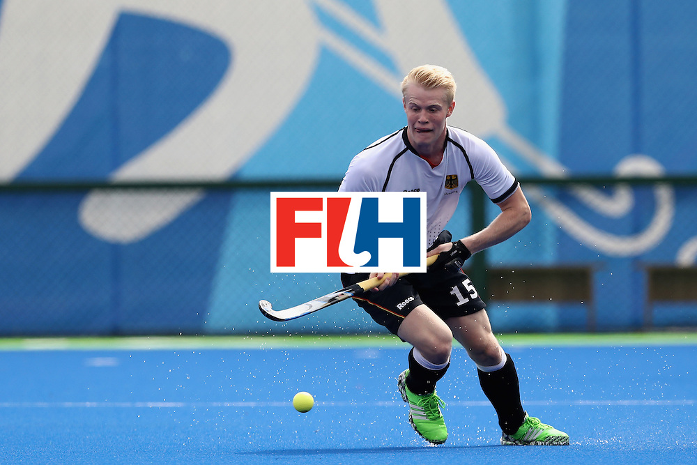 RIO DE JANEIRO, BRAZIL - AUGUST 08:  Tom Grambusch #15 of Germany looks to pass against India during a Men's Pool B match on Day 3 of the Rio 2016 Olympic Games at the Olympic Hockey Centre on August 8, 2016 in Rio de Janeiro, Brazil.  (Photo by Sean M. Haffey/Getty Images)