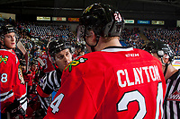 KELOWNA, CANADA - APRIL 7: Referee Kevin Bennett examines Brett Clayton #24 of the Portland Winterhawks at the bench after an injury on the ice against the Kelowna Rockets on April 7, 2017 at Prospera Place in Kelowna, British Columbia, Canada.  (Photo by Marissa Baecker/Shoot the Breeze)  *** Local Caption ***