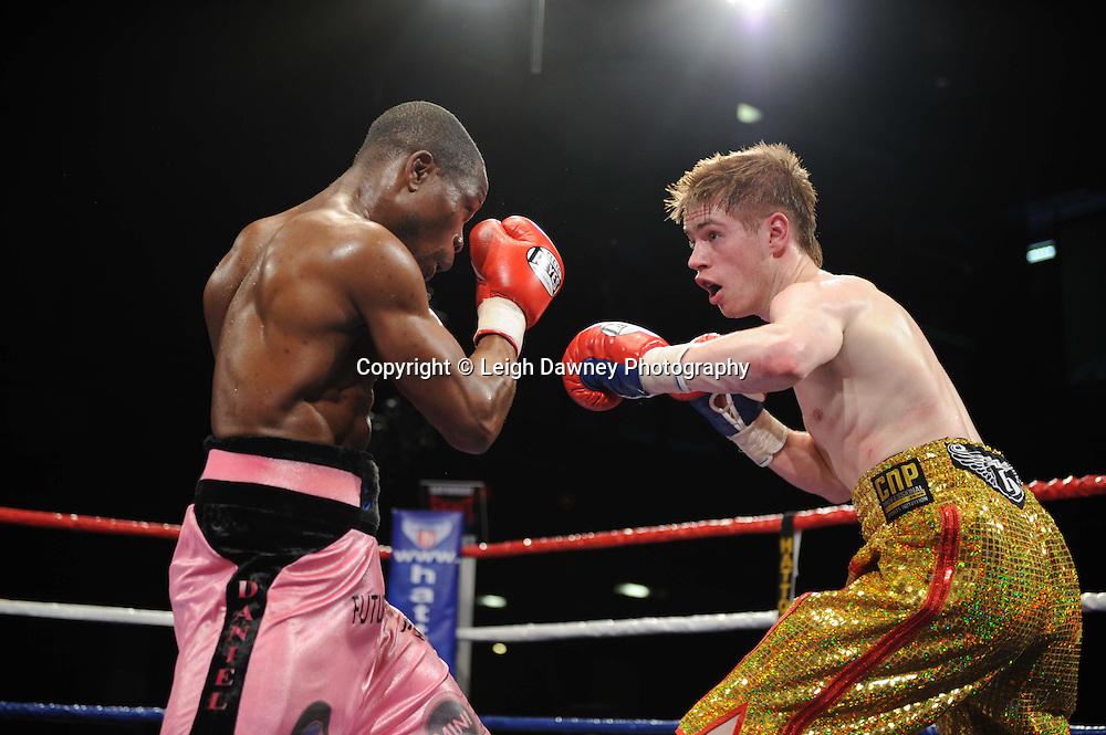 Featherweight Joe Murray (gold shorts) defeats Daniel Kodjo Sassou at the Reebok Stadium on Saturday 26th February 2011. Hatton Promotions. Photo credit © Leigh Dawney.