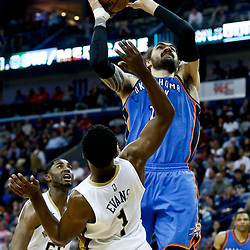 Jan 25, 2017; New Orleans, LA, USA; Oklahoma City Thunder center Steven Adams (12) shoots over New Orleans Pelicans guard Tyreke Evans (1) during the second quarter of a game at the Smoothie King Center. Mandatory Credit: Derick E. Hingle-USA TODAY Sports