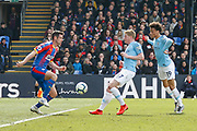 Manchester City midfielder Kevin De Bruyne (17) kicks the ball towards goal past Crystal Palace defender Scott Dann (6) during the Premier League match between Crystal Palace and Manchester City at Selhurst Park, London, England on 14 April 2019.