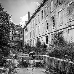 Abandoned Glencoe-Auburn Hotel in Cincinnati Ohio. The Glencoe-Auburn Hotel and Glencoe-Auburn Place Row Houses were built in the late 1800's and are listed on the U.S. National Register of Historic Places. The complex is currently abandoned and in extremely poor condition.