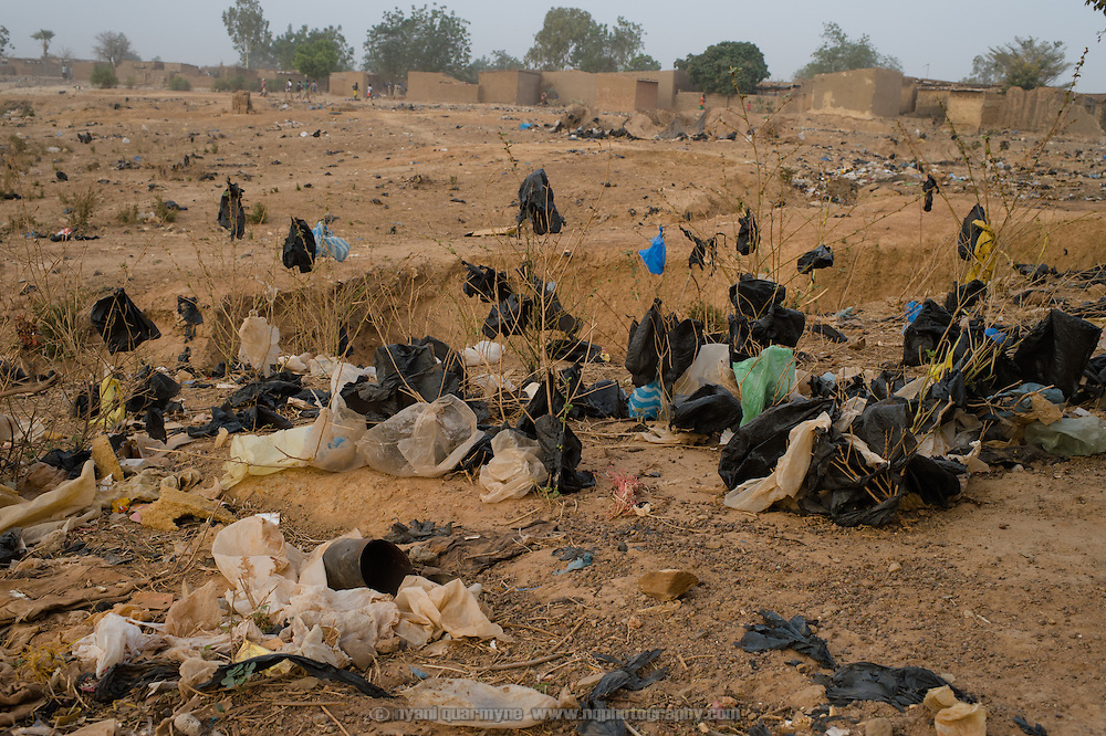 Plastic bags and other waste litter the landscape in the informal settlement of Zongo in Burkina Faso's capital, Ouagadougou, on 24 February 2016. Plastic waste - and plastic bags in particular - is a major problem, and a source of pollution on a massive scale.