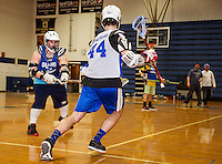 David McDonald and Kris Shepard work through drills with the Lacrosse team in the Gilford High School gym Friday afternoon.  (Karen Bobotas/for the Laconia Daily Sun)