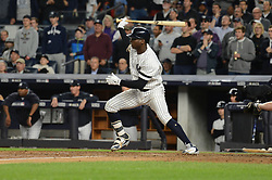 October 18, 2017 - Bronx, NY, USA - The New York Yankees' Didi Gregorius hits an RBI single in the fifth inning against the Houston Astros in Game 5 of the American League Championship Series at Yankee Stadium in New York on Wednesday, Oct. 18, 2017. (Credit Image: © Andrew Savulich/TNS via ZUMA Wire)