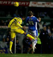 Leeds Armando Sa (left) and Birmingham's Rowan Vine (right) contest the ball