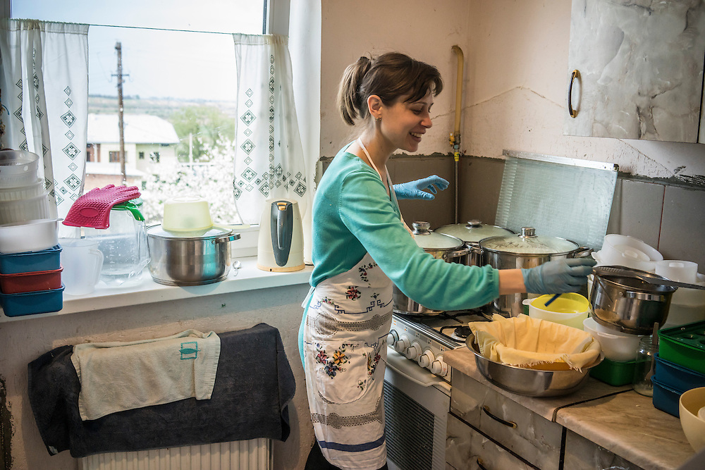 Olga Anisimova, 33, who fled from Yalta on the Crimean peninsula, prepares cheese in her kitchen on Tuesday, April 28, 2015 in Dubliany, Ukraine. The Russian takeover of Crimea forced Anisimova and her family to flee to the suburb of Lviv, where she has started a business selling home-made fresh cheese, though her hope is to move to Slovakia. CREDIT: Brendan Hoffman/Prime for the Wall Street Journal UKRMIGRATION