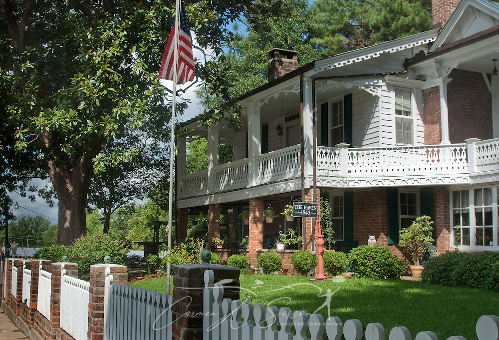 "An American flag flies in front of The Haven in Columbus, Miss. Aug. 16, 2010. The house was built in 1843 by two ""free men of color"" and exemplifies the South Carolina low-country style. (Photo by Carmen K. Sisson/Cloudybright)"