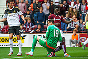 Danny Ward takes an elbow to the face during the Ladbrokes Scottish Premiership match between Heart of Midlothian and Aberdeen at Tynecastle Stadium, Gorgie, Scotland on 20 September 2015. Photo by Craig McAllister.