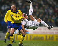 Photo. Aidan Ellis.<br />Bolton Wanderers v Arsenal.<br />FA Barclaycard Premiership.<br />20/12/2003.<br />Bolton's Emerson Thome attempts a overhead kick whilst Arsenal's Pascal Cygan challenges