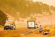 "03 JUNE 2011 - SPRINGERVILLE, AZ: Smoke shrouded traffic on US Highway 180 north of Alpine and Nutrioso. The road is closed from Nelson Reservoir to south of Hannigan's Meadow. High winds and temperatures have continued to complicate firefighters' efforts to get the Wallow fire under control. The  mandatory evacuation order for Alpine was extended to Nutrioso, about 10 miles north of Alpine and early Friday morning fire was reported on the south side of Nutrioso. The fire grew to more than 106,000 acres early Friday with zero containment. A ""Type I"" incident command team has been called in to manage the fire.  PHOTO BY JACK KURTZ"