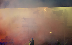 CHESTER, ENGLAND - Friday, October 23, 2015: LFC Television cameras are obscured by the smoke as Benfica supporters let off flares and smoke bombs during the Premier League International Cup match against Liverpool at the Deva Stadium. (Pic by David Rawcliffe/Propaganda)