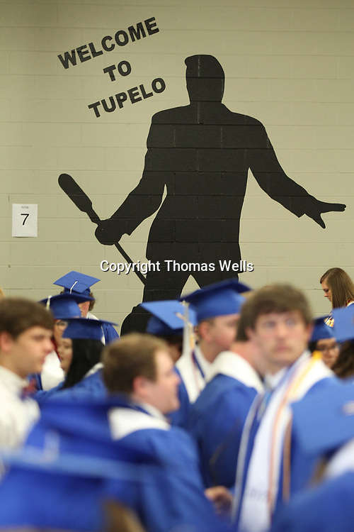 Saltillo Students gather backstage before Saturday's graduation at the BancorpSouth Arena in Tupelo.
