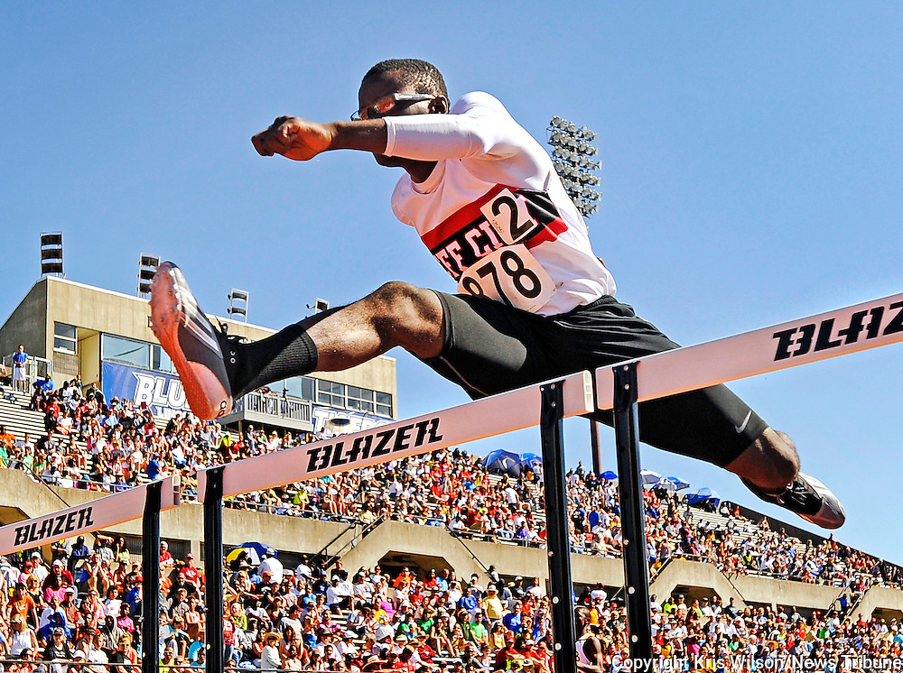 Kris Wilson/News Tribune<br /> Jefferson City's Mervyn John clears a hurdle while competing in the boys 110-meter high hurdles preliminaries during the 2013 MSHSAA Class 3 and 4 Track and Field Championships at Lincoln University's Dwight T. Reed Stadium.