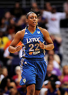 Sep 11, 2011; Phoenix, AZ, USA; Minnesota Lynx guard Monica Wright (22) reacts on the court while playing against the Phoenix Mercury at the US Airways Center.  The Lynx defeated the Mercury 96-90. Mandatory Credit: Jennifer Stewart-US PRESSWIRE