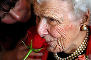 Melva Mae Cadmus Radcliffe smells a rose given to her as a gift fro 110th birthday at the Waterford Glen assisted living facility, where she lives.  Melva becomes the 89th oldest person in the world.