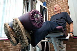 Access to services, Disabled man in the gym; using Leg Extension,