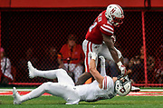 Nebraska Cornhuskers running back Mikale Wilbon (21) shoves Northern Illinois Huskies safety Jackson Abresch (13) to the ground while carrying the ball during a game on Saturday at Memorial Stadium in Lincoln. (Matt Gade / Republic)