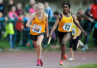 20 Aug 2016: Chisom Ugwueru, right, Clare, hands the baton to Ailbhe Doherty who runs the final leg of Girls U14 4x100 Relay.   2016 Community Games National Festival 2016.  Athlone Institute of Technology, Athlone, Co. Westmeath. Picture: Caroline Quinn