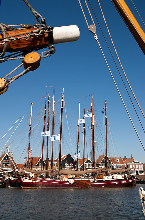 Big, beautiful sailing vessels tie up at the Volendam docks, a popular day trip from Amsterdam.