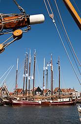 Big, beautiful sailing vessels tie up at the Volendam docks, a popular day trip from Amsterdam.