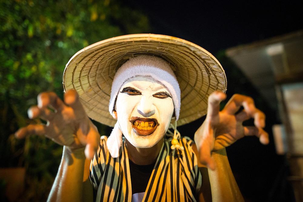 OKINAWA, JAPAN - AUGUST 17 : Chondara clown posed for a photo after a modern Eisa folk dance performance in Higashi village during the Obon festival to honour the spirits of their ancestors on August 17, 2016, Okinawa prefecture, Japan.  (Photo by Richard Atrero de Guzman/NURPhoto)
