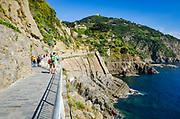 Tourists on the Via dell'Amore (The Way of Love), Riomaggiore, Cinque Terre, Liguria, Italy