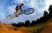 BMXer, Ian Gunner, getting some air, doing a jump,