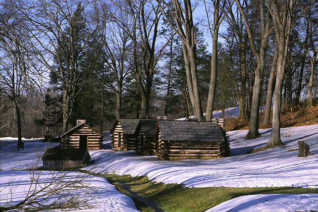 Revolutionery War soldiers' log huts & springhouse; historic; snow; Valley Forge National Historical Park; Valley Forge; PA; Pennsylvania; winter