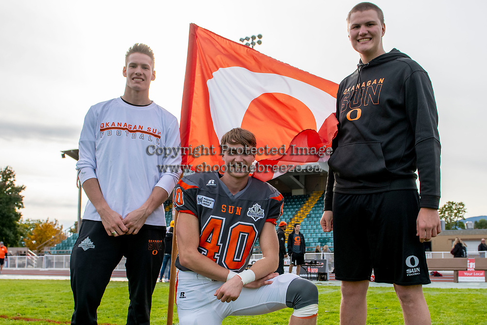 KELOWNA, BC - OCTOBER 6: Brothers Connor Johnstone #15, Liam Johnstone #40 and Kaleb Johnston #67 of Okanagan Sun pose for a photo on the field after the win against the VI Raiders at the Apple Bowl on October 6, 2019 in Kelowna, Canada. (Photo by Marissa Baecker/Shoot the Breeze)
