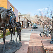 A statue of a small boy helping a small girl mount a horse in Golden, Colorado, just outside Denver at the eastern edge of the Rocky Mountains.