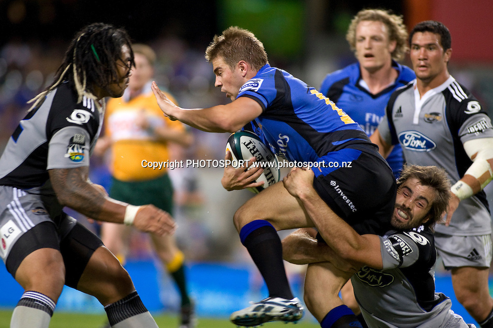 Drew Mitchell is tackled by Conrad Smith during the Super 14 rugby union match, Round 9, Western Force v Hurricanes, Subiaco Oval, Perth, Australia, Friday 10 April 2009. Score was Hurricanes 28 - Force 27 in front of 20,737 fans. Photo: Christian Sprogoe/PHOTOSPORT